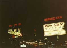 Desert Inn's sign and lighted driveway/valet parking - night - August 1990