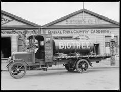 'Big Tree' petrol tanker alongside S Wright & Co, carriers of Wanganui, circa Photograph probably taken by either Frank J Denton or Mark Lampe. Portable Record Player, Vinyl Record Player, Vintage Cars, Antique Cars, Floating Head, Ear Hair Trimmer, Big Tree, Town And Country, New Zealand