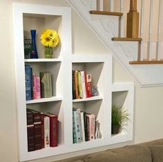 In the wall, under the stairs, bookshelf.
