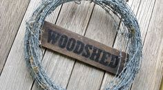 the woodshed sign
