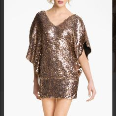 Alberto Makali Sequin Mini Dress / Tunic Beautiful dolman sleeve banded bottom v-neck mini dress or tunic. Can be worn as a dress to a formal event or pair with slacks or leggings for a beautiful evening look. Matte gold sequin with purple tones. The sequin looks rich and classy.  Never worn, original tags attached. Alberto Makali Dresses Mini