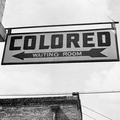 Jim Crow Laws. Laws were made to segregate 'coloured' people from white people.  Some laws were that 'coloured' people couldnt use the same water fountain or waiting areas.