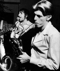 Keith Moon and David Bowie at a jam session at Peter Sellers' 50th Birthday Party, at Peter Sellers' House, Los Angeles, September 1975. Photo by Terry O'Neill. (Peter Sellers' birthday is the 8th, Terry O'Neill recalls the party on the 1st.) David Bowie nicknamed the group Trading Faces.