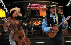 """Ukulele Ray once played the Saddle Ranch Chop House nightly, performing table-to-table comedy and music. From that, Ray wrote the theme song, """"Saddle Ranch Cowboy"""" parody of the Glen Campbell hit, """"Rhinrstone Cowboy."""""""