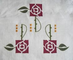 Macintosh Rose:This design was inspired by the geometric roses of Charles Rennie Mackintosh, the Scottish artist and designer. It can be used singly or grouped as here in a composition for a row of windows. Seen here in natural Irish linen with wine, dark green and antique gold motifs. 4 1/2 long x 4 3/4 inches wide, $45.00. Also available as a stencil.