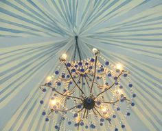 Under the big top ceiling.