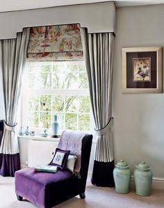 Traditional living room with ornamental vases / love the colour of the chair
