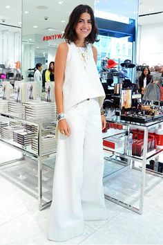 Leave it to Leandra Medine to freshen up the trend du jour, the all-white outfit, with massive proportions. We don't know if men are repelled by the double bell-bottom look, but we're intrigued. #refinery29 http://www.refinery29.com/fashion-risks#slide-7