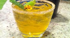 """""""Marigold:"""" 1 ½ oz. Del Maguey Mezcal Vida, ¾ oz. White Crème de Cacao, ¾ oz. fresh lemon juice, tabentun Liqueur, for rinse, Sugar and Oaxacan sea salt, for rimming  Marigold, for garnish. Rinse a chilled coupe glass with Xtabentun, and then rim glass with sugar and Oaxacan sea salt. Add the remaining ingredients, to a cocktail shaker. Add ice, shake until chilled, and strain into the prepared coupe glass. Garnish with the marigold."""
