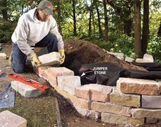 Build a raised garden bed from natural rough-cut stone that blends perfectly into the landscape. This brick raised garden bed is gorgeous. Stone Raised Beds, Raised Flower Beds, Building A Raised Garden, Raised Garden Beds, Raised Gardens, Small Retaining Wall, Retaining Walls, Stone Flower Beds, Stone Planters