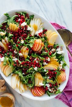 This gorgeous salad is bursting with flavor and fresh fruit! Featuring pomegranate Bartlett pear Honeycrisp apple goat cheese pecans and arugula this salad will brighten up your holiday table. Pomegranate Salad, Pear Salad, Apple Salad, Salad With Fruit, Vegetarian Recipes, Cooking Recipes, Healthy Recipes, Cooking Games, Cooking Classes