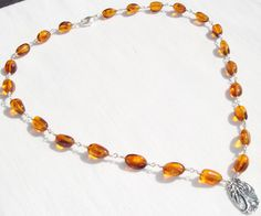 Wire Wrapped Amber Necklace, Sterling Silver Tree Pendant, Sterling Wire Wrapped Gemstones, Inspirational Pendant, Sterling Silver Pendant by ClareCorreCreations on Etsy https://www.etsy.com/listing/233029996/wire-wrapped-amber-necklace-sterling