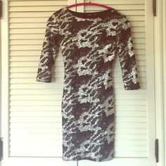 """LF Millau Sequin Bodycon Dress XS Black Silver NYE A beautiful Bodycon fully sequined dress by Millau from LF. A size XS. Only worn twice. Measures 32"""" from top of shoulder to bottom of hem, 14"""" at bust. Stretchy material. 3/4 sleeves, amazing dress  LF Dresses"""