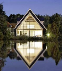 A peaceful, comfy white house I can call a home with glass and a view to water.