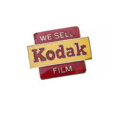 "Pins ""We Sell Kodak Film"", c. 1950."