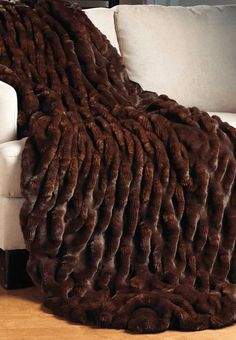 With remarkable realism, Mahogany Mink captures the subtle, gradient color of nature. Velvet-lined, Mahogany Mink faux fur throws are machine wash/line dry. Faux Fur Blanket, Faux Fur Throw, Fuzzy Blanket, Warm Blankets, Throw Blankets, Fleece Blankets, Piel Natural, Mahogany Color, Fabulous Furs