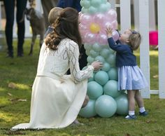 pop... pricess charlotte first words in public as she hug balloons
