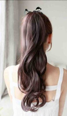 Add a ribbon to your high ponytail for a youthful look. Even prettier with…