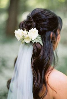 Featured Photographer: Leo Patrone Photography; Elegant wavy wedding hairstyle with simple veil;