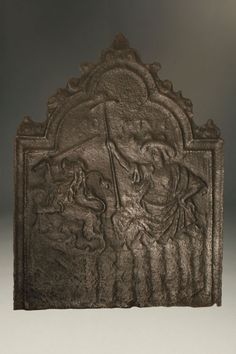 17th century Dutch fire back featuring man and lion, circa 1680. #antique #fireback