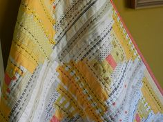 Yellow, grey, white log cabin - Molly Flanders. Very neat effect with over-size quilting stitches.