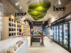Wine Republic, Fitzroy-love the hanging sculptural piece out of wine bottles- retail design