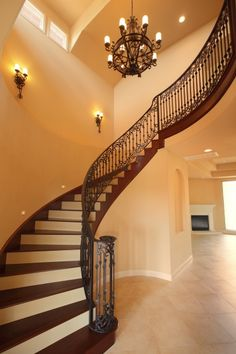 Grand staircase and stunning chandelier make for a beautiful entryway.