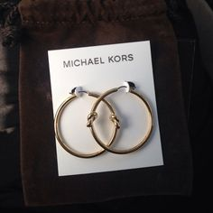 Michael Kors Earrings Michael Kors gold colored earrings. New with tags and box. Never been used. Michael Kors Accessories