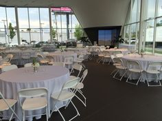 White Hercules chairs and round tables at the Jim Ellis Audi Atlanta showroom. Table Linen Rentals, Table Linens, Corporate Event Planner, Corporate Events, Johns Creek, Round Tables, Hercules, Showroom, Audi
