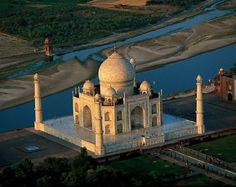 Taj Mahal. Agra, India. If the palace doesn't take your breath away, the love story behind it's creation sure will!