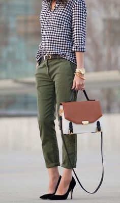 Checked gingham blouse, army green slacks, belt, and structured bag with pointy heels for a casual fall look.