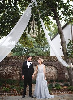 Tree drapes and chandeliers for glamourous outdoor wedding dressing - Inspired by This