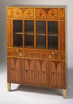 Koloman Moser, Caspar Hrazdil, and  Wiener Werkstätte, Thuya and Lemon Wood, Brass, and Glazed Glass Bookcase, Austria, 1903.