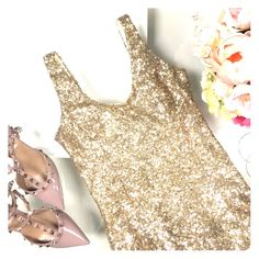 Gold sequenced dress Gold sequenced body con dress with a low back. Perfect for parties and New Years! NWOT Tobi Dresses Mini