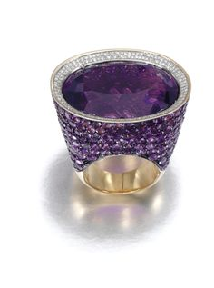 Designed as an oval amethyst within a double row border of single-cut diamonds, the mount raised and pavé-set with circular-cut amethysts, size M, French import marks, signed Paul.