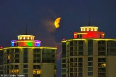 A full moon over the dazzling Palisade Palms towers