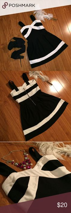 Black & White colour block dress NWOT 💞Brand-new with out tag, beautiful black and white colour block dress.   Versatile can be worn for many events and occasions. Can accessories with a statement necklace or contrast by wearing different color shoes or belt.   Great affordable adorable dress. 💞  💙Shoes And Necklace not for sale. All sales are final and no returns. CALS Dresses