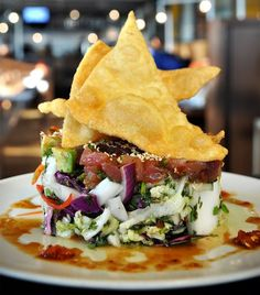 Founding Farmers Restaurant in Washington, DC:    Spicy Ahi Tuna Poke Salad with Raw Ahi Tuna, Napa Cabbage, Avocado, Fried Wonton and a Ginger-Sesame Vinaigrette.