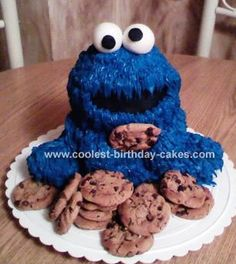 Baby Cookie Monster Cake: This Cooke Monster cake was done using the Wilton 3D teddy bear pan (I followed the recommendation for using one pound cake mix and one yellow cake mix).