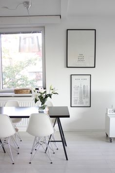 Homevialaura | kitchen | dining space | white lilies | Eames DSR chair | Tikau basket | Kartell Ge lamp