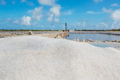 Mound of salt with windmill in the background, Grand Turk, Turks and Caicos Islands.