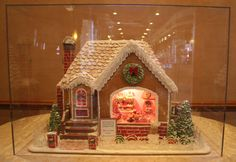 This is a house that my husband and I had created for Eddies Bakery/café in Fresno, CA. There's lots of fun and yummy things going on inside....please come in!!