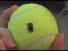 Unlocking a car with a tennis ball.