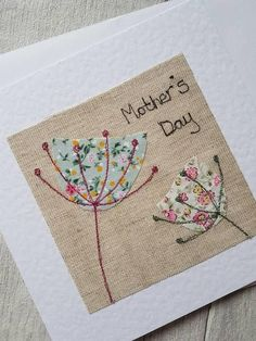 This pretty original textile Mother's day card has been designed and made by me. The textile artwork has been produced using appliqué and free motion machine embroidery, and has been attached to a linen effect white greeting card. The card is blank inside for your own message.