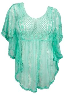 Available in junior plus size 1XL, 2XL, 3XL. Plus size poncho top features crochet detailing in front and back. Asymmetric bottom design. Sheer lace material. Scoop neck design. Polyester blend.