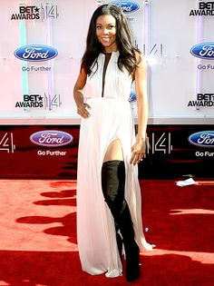Gabrielle Union mixed it up at the 2014 BET Awards, showing off a pair of thigh-high black boots under the slit of her draped white gown.