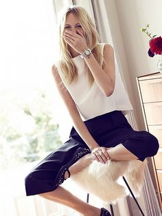 Poppy Delevingne wearing a sleeveless white tank top with leather bottoms and embellished flats. // Photo by Garance Dore