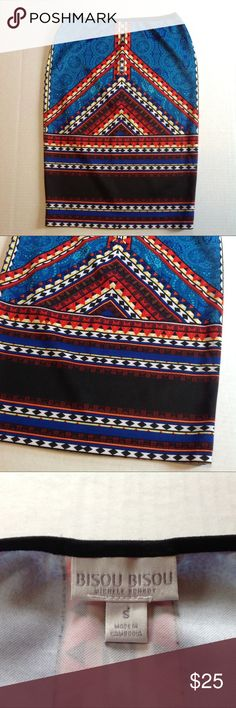 """Bisou Bisou Tribal Bodycon Stretch Pencil Skirt Description: unlined, fabric can stretch Condition: excellent - no holes or stains Measurements: length 23"""", waist width 13""""  Please see pictures for measurements & fabric content. Comes from a smoke-free home.  Don't like the price, make a reasonable offer. Happy shopping! F2 Bisou Bisou Skirts Pencil"""