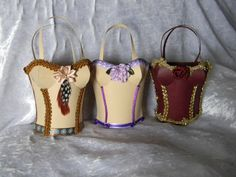Corsets in apricot and burgundy