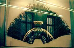 Penacho de Moctezuma or Moctezuma's Headress. Because of their role in elite and ritual costumes, quetzal feathers were an important element in Mesoamerica. The famous headdress housed in Vienna that is often called Moctezuma's Headdress included 500 hundred quetzal feathers. Other evidence indicates that such headdresses existed and were part of royal or ritual regalia; on the Stone of Tizoc the ruler shown in the battle dress wears a hummingbird helmet with a great quetzal-feather crown.